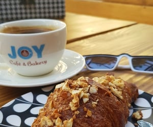coffee, croissant, and sunnyday image