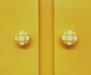 cabinets, knobs, and yellow image