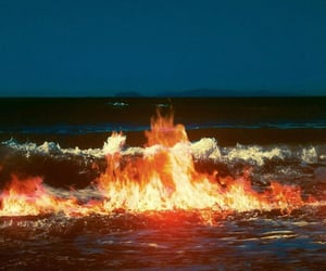fire, water, and ocean image