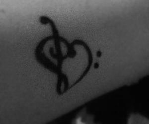 arm, heart, and music image