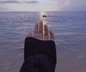 hand and sea image