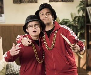 brothers, gold chain, and red jacket image