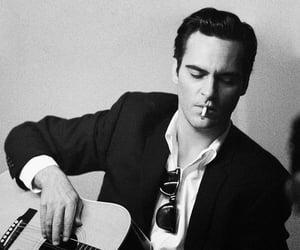 joaquin phoenix, walk the line, and Johnny Cash image