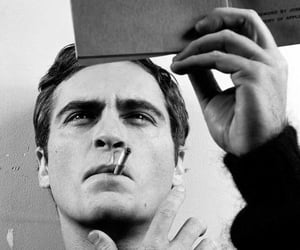 black and white, joaquin phoenix, and book image