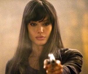 Angelina Jolie, salt, and gun image