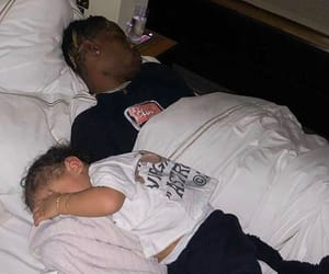 travis scott, kylie jenner, and stormi image