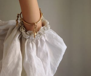 white, gold, and bracelet image