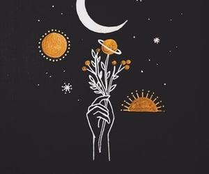 sun, hand, and moon image