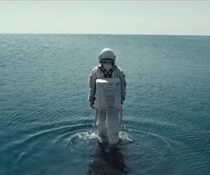 astronaut, ocean, and space suit image
