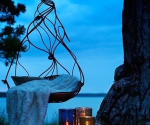 candles, chair, and hanging chair image