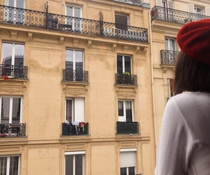 balcony, beret, and buildings image