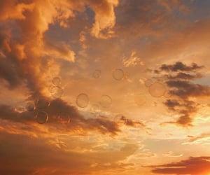 sky, bubbles, and orange image