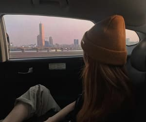 beanie, driving, and fashion image