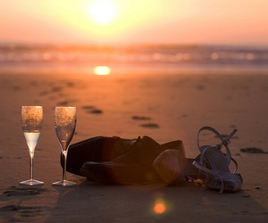 beach, champagne, and sunset image