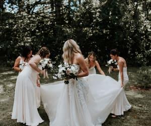bride, bridesmaids, and celebration image
