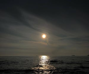 light, moon, and ocean image