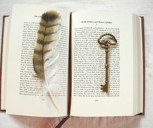 book, key, and feather image