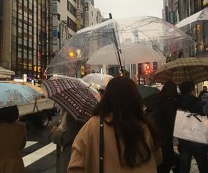 city, rain, and umbrella image