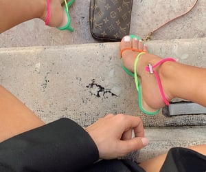 louis vuitton bag and colorful strappy heels image