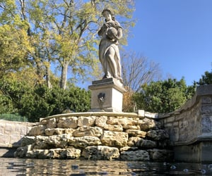 fountain, rocks, and statue image