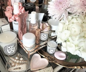 candles, cosmetics, and flowers image