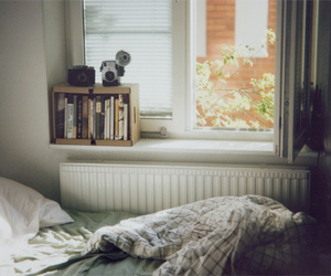 bed, books, and window image