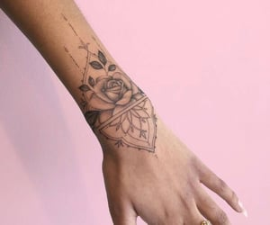 arm, hand, and rose image