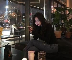 black, turtleneck, and cellphone image