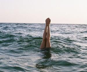 sea, legs, and ocean image