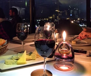 city, dinner, and glass of wine image