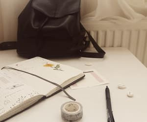 bag, journal, and pen image