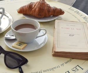 book, croissant, and cafe image