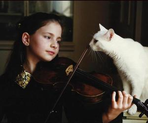 cat, girl, and violin image