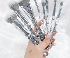 silver and makeup brushes image