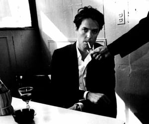 black and white and hugh grant image