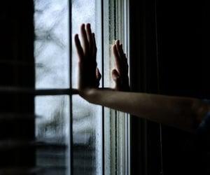 hands, window, and rain image