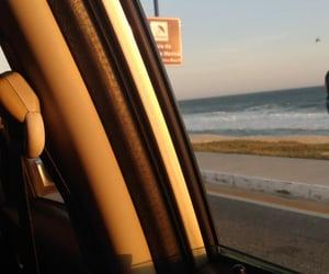 car, sun, and sea image