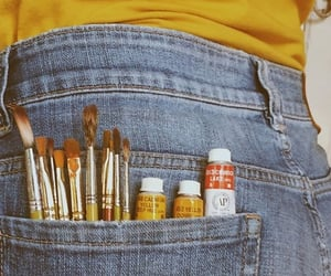 Brushes, colours, and jeans image