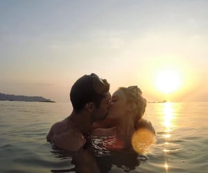 couple, sunset, and water image