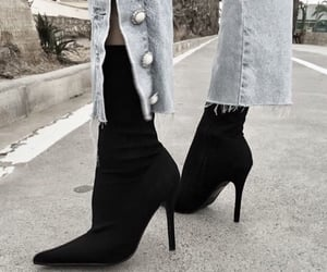 black heels and blue jeans image