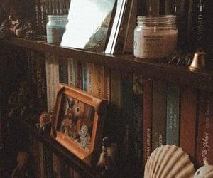 books, bookshelf, and candles image