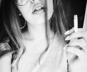 black and white, cigarrillo, and girl image