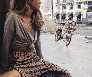 leopard, outfit, and bike image
