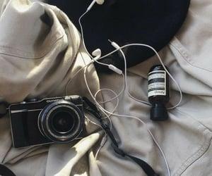 camera, headphones, and jacket image