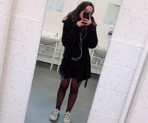 black coat, adidas shoes, and denim skirt image