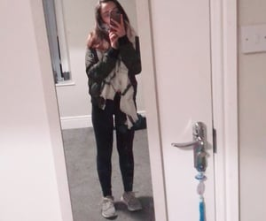 green jacket, scarf, and adidas shoes image
