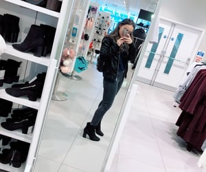 black boots, black jeans, and leather jacket image