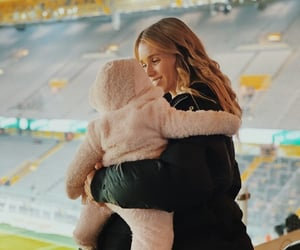 baby, stadium, and football family image