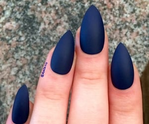 matte nails and stiletto navy blue image