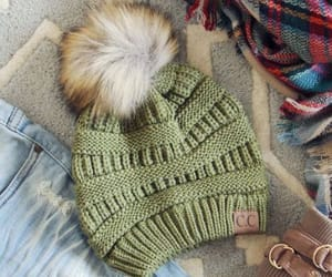 furry balls, wool beanies, and christmas beanies image